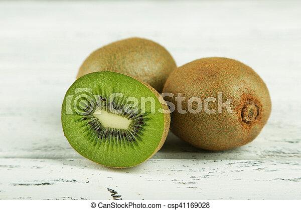 Kiwi fruit on white wooden background - csp41169028