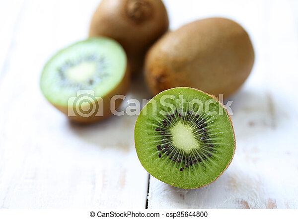 Kiwi fruit on white wooden background - csp35644800