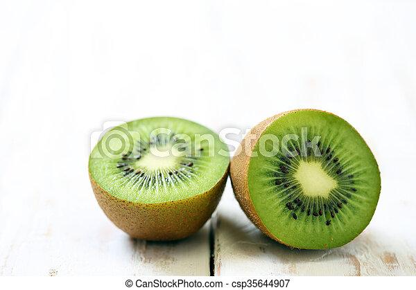 Kiwi fruit on white wooden background - csp35644907