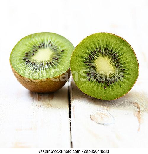 Kiwi fruit on white wooden background - csp35644938