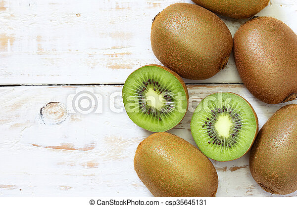 Kiwi fruit on white wooden background - csp35645131