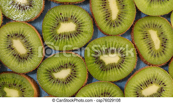 kiwi slices juicy-top view - csp76029108