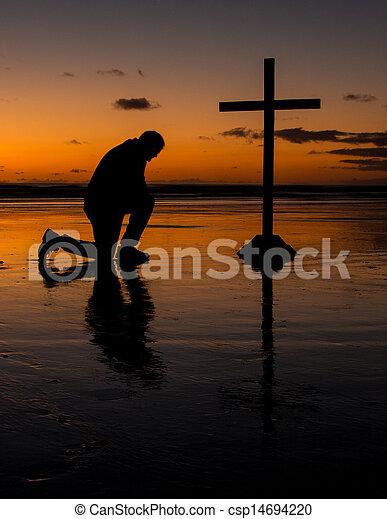 Kneeling Before The Cross - csp14694220