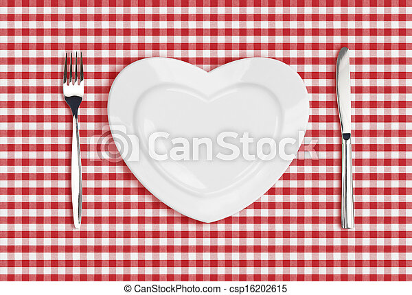 Knife, heart plate and fork on checked tablecloth - csp16202615