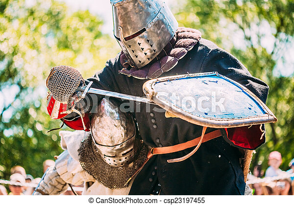 Knights In Fight With Sword. Restoration Of Knightly Battle - csp23197455