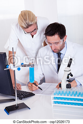 Lab technicians at work in a laboratory - csp12026173