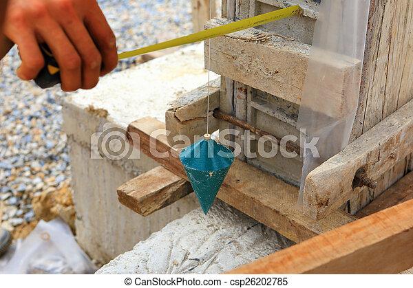 labor man using a plumb bob for check  - csp26202785