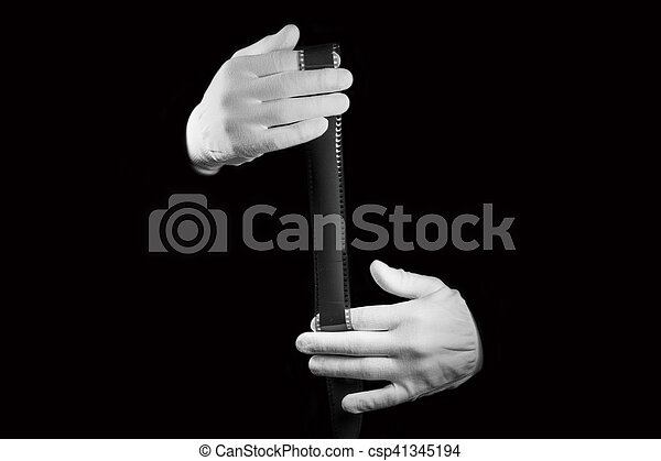 laboratory, hands in white gloves hold a black and white film - csp41345194