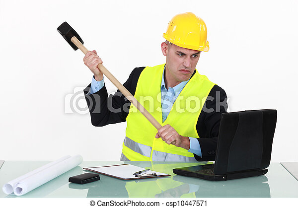 Laborer destroying computer with hammer - csp10447571