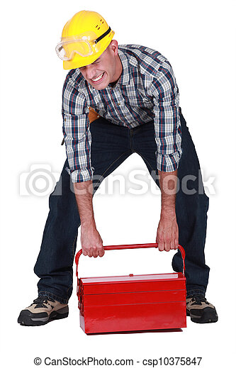 laborer lifting heavy toolbox - csp10375847