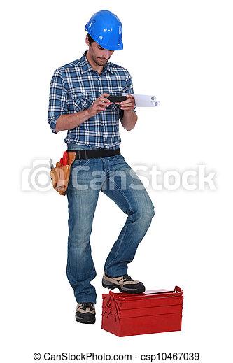 Laborer using mobile phone - csp10467039