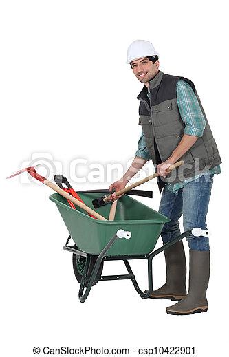 Laborer with wheelbarrow - csp10422901