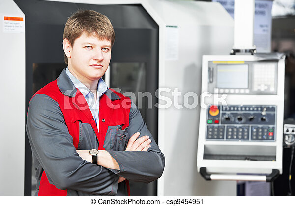 laborer worker with machining tool center - csp9454951