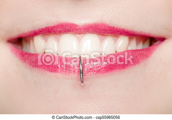 Detail Of A Labret Piercing On A Smiling Woman S Mouth