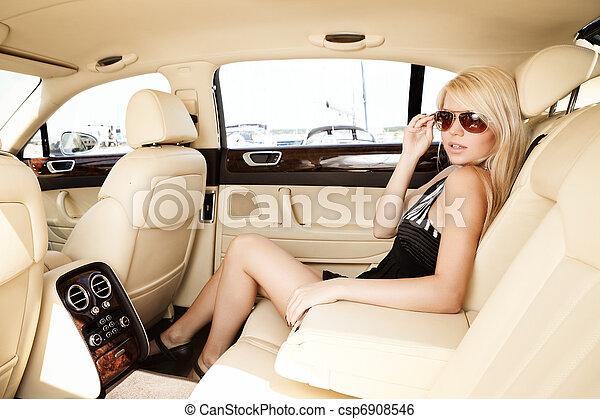 Lady in a luxury car - csp6908546