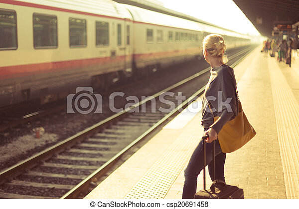Lady waiting at the railway station. - csp20691458