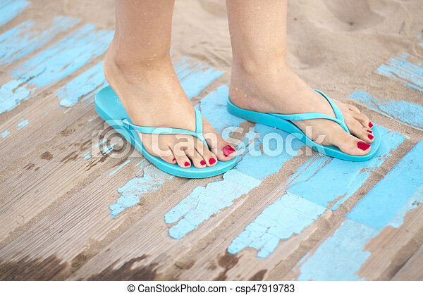 Lady's feet in sandals on beach - csp47919783