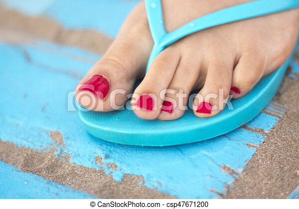 Lady's feet in sandals on beach - csp47671200