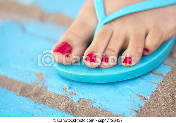 Lady's feet in sandals on beach - csp47726437