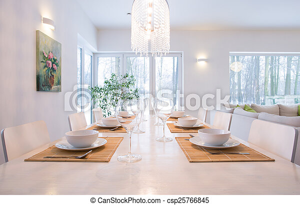 Laid table in dining room - csp25766845