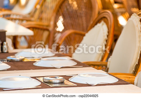 laid tables in a summer cafe in the resort - csp22044925