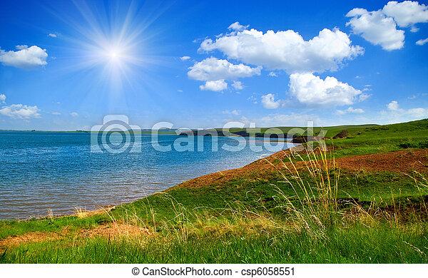 lake and cloudy sky - csp6058551