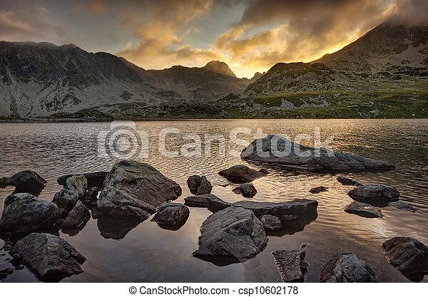 lake and mountain at sunset - csp10602178