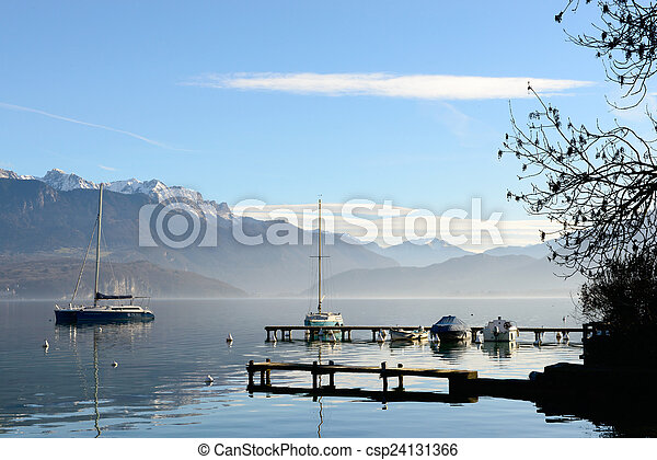 Lake Annecy in France in autumn at sunset - csp24131366