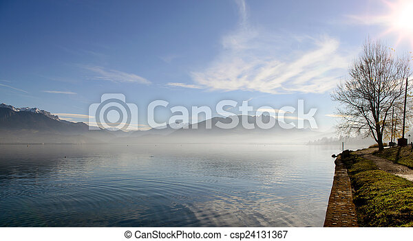 Lake Annecy in France in autumn at sunset - csp24131367