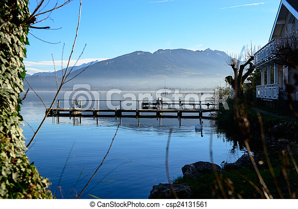 Lake Annecy in France in autumn at sunset - csp24131561
