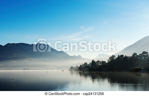 Lake Annecy in France in autumn at sunset - csp24131256