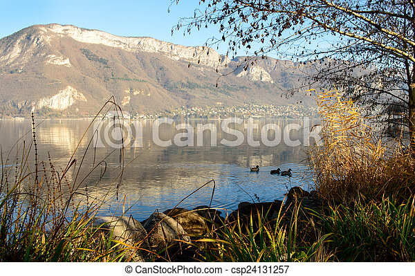 Lake Annecy in France in autumn at sunset - csp24131257