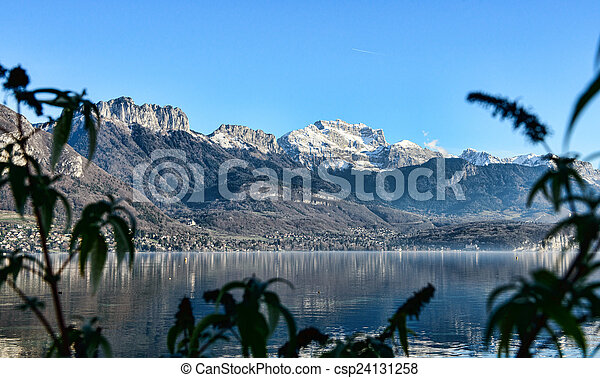Lake Annecy in France in autumn at sunset - csp24131258