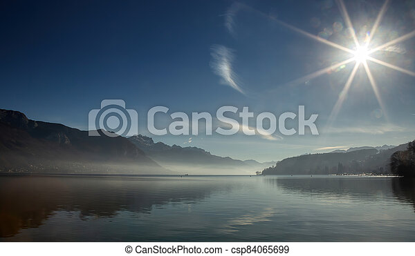 Lake Annecy in France in winter at morning - csp84065699
