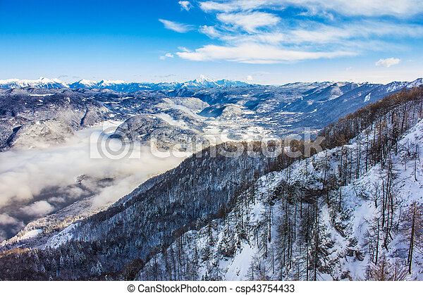 Lake Bohinj surrounded by mountains of Triglav national park - csp43754433