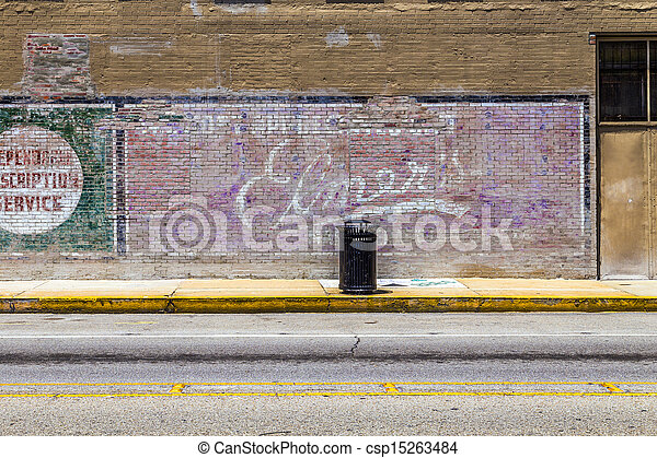Lake Charles, USA - AUGUST 9:   old painted advertising at the wall on August 9, 2013 in Lake Charles, USA. Painted ads on brick walls were common in the first alf of last century in america. - csp15263484