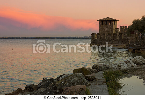 Lake Garda sunset with the tower of The Scaliger Castle - csp12535041