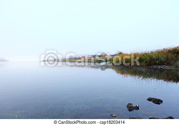 Lake in autumn in misty morning - csp18203414