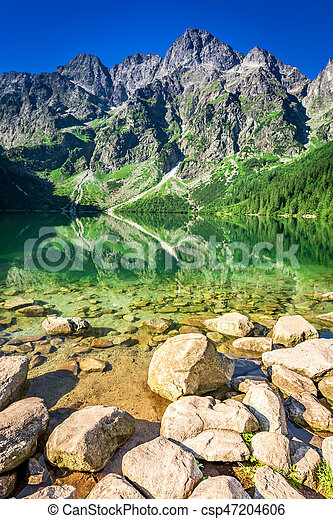 Lake in the mountains at sunrise in summer, Poland, Europe - csp47204606