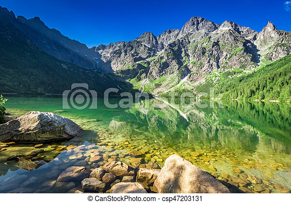 Lake in the mountains at sunrise, Poland, Europe - csp47203131
