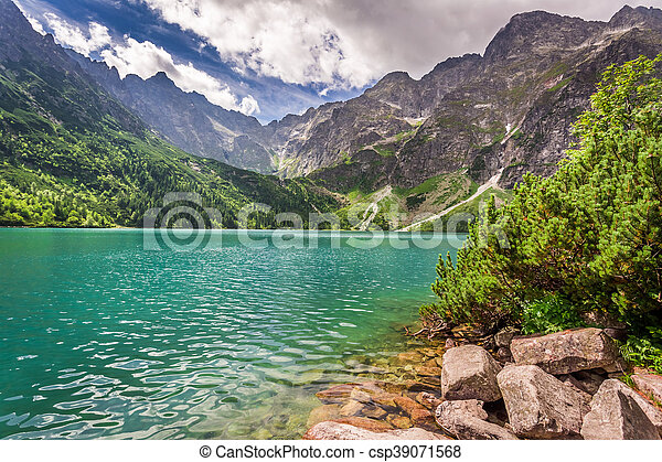 Lake in the mountains at sunrise - csp39071568