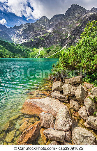 Lake in the mountains at sunrise - csp39091625