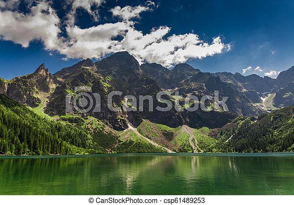 Lake in the Tatra Mountains at sunrise, Poland, Europe - csp61489253