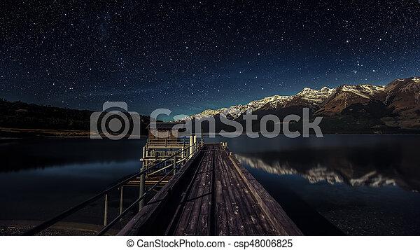 Lake pier at night - csp48006825
