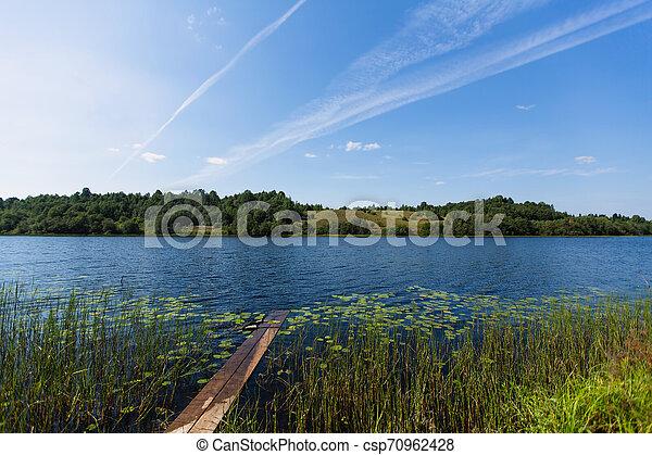 Lake, rural landscape. Remote village in Karelia Republic, Russia. - csp70962428