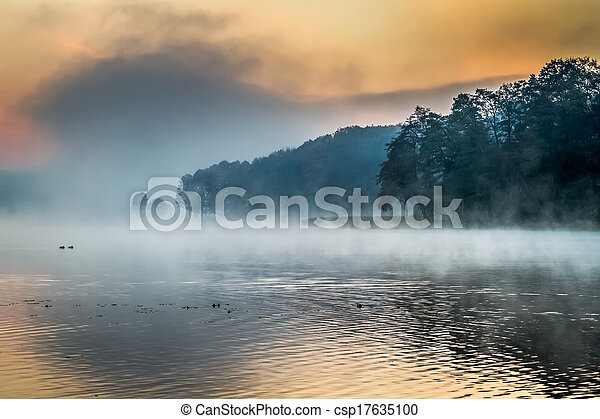 Lake with the fog at sunrise - csp17635100