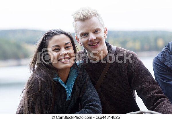 lakeside, couple, multiethnic, camping, sourire - csp44814825