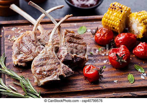Lamb ribs grilled on cutting board with vegetables - csp40799576