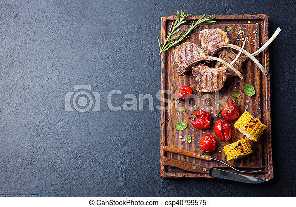 Lamb ribs grilled with roasted vegetables Top view - csp40799575