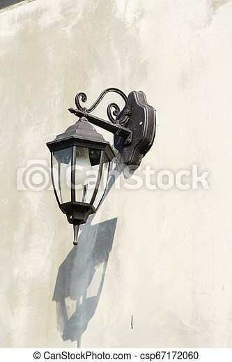 Lamp beside the brick wall vintage style - csp67172060